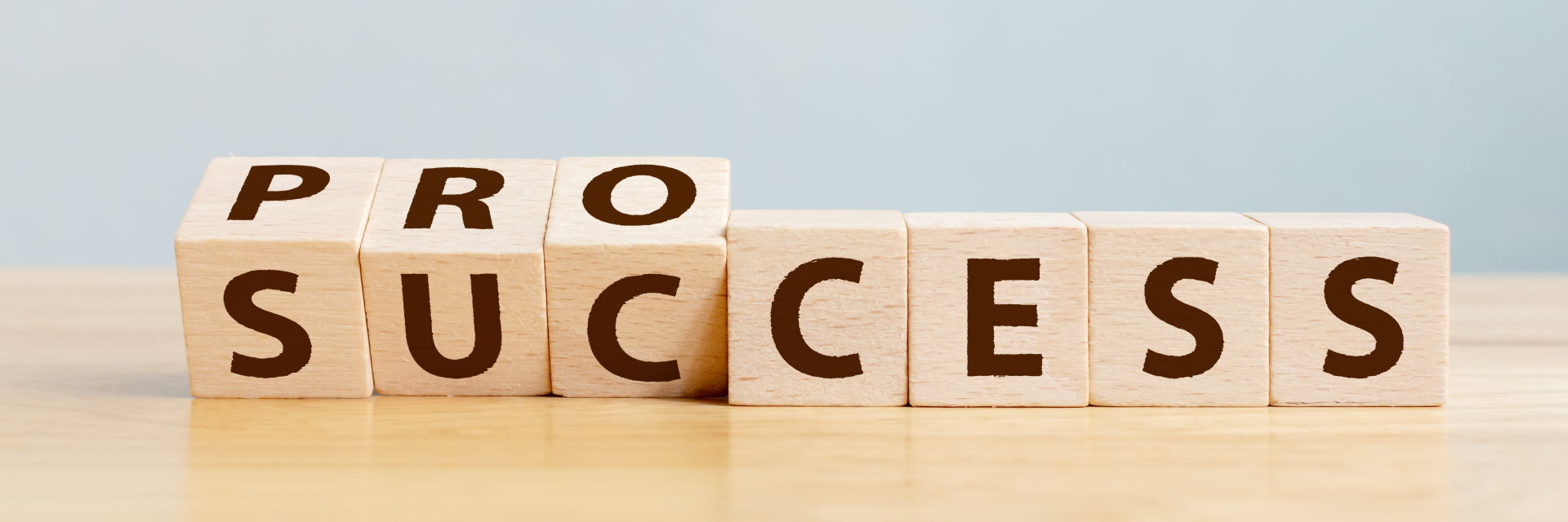 Wooden blocks that spell process and success